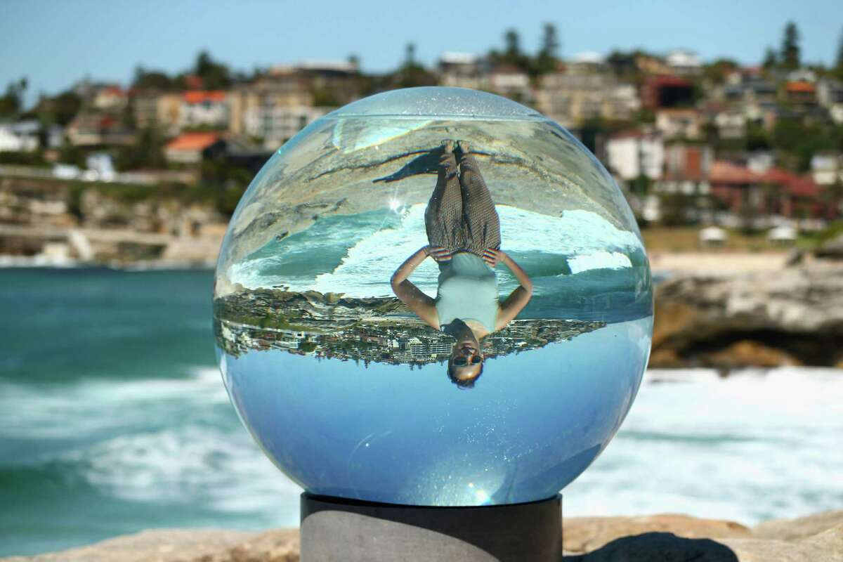 Artist Lucy Humphrey poses behind her sculputure 'Horizon' during the 2013 Sculptures by the Sea exhibition at Bondi on October 24, 2013 in Sydney, Australia.