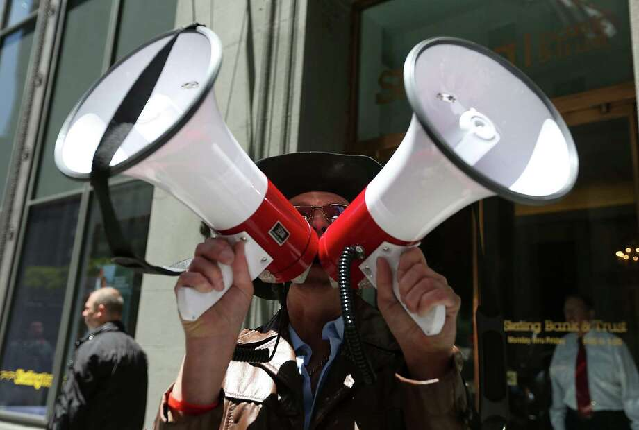 A tea party protester  makes his pitch against President Barack Obama outside a presidential fundraiser in San Francisco. Republicans seem to be in an internecine fight for political purity. Photo: Justin Sullivan / Getty Images