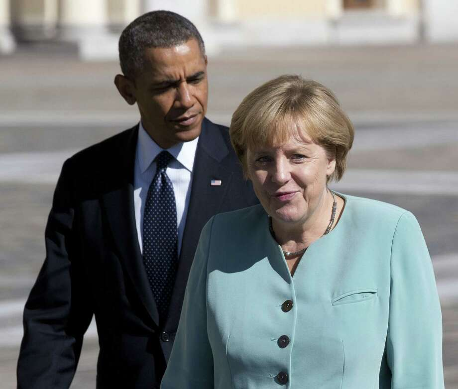 Back in September, during happier diplomatic times between the two world leaders, President Barack Obama and German Chancellor Angela Merkel walked together toward the Konstantin Palace in St. Petersburg. A spying scandal has erupted since then, and our readers weigh in on the issue. Photo: Alexander Zemlianichenko / Associated Press