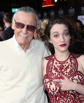 "Producer Stan Lee (L) and actress Kat Dennings attend the premiere of Marvel's ""Thor: The Dark World"" at the El Capitan Theatre on November 4, 2013 in Hollywood, California.  (Photo by David Livingston/Getty Images) Photo: David Livingston, Getty Images"