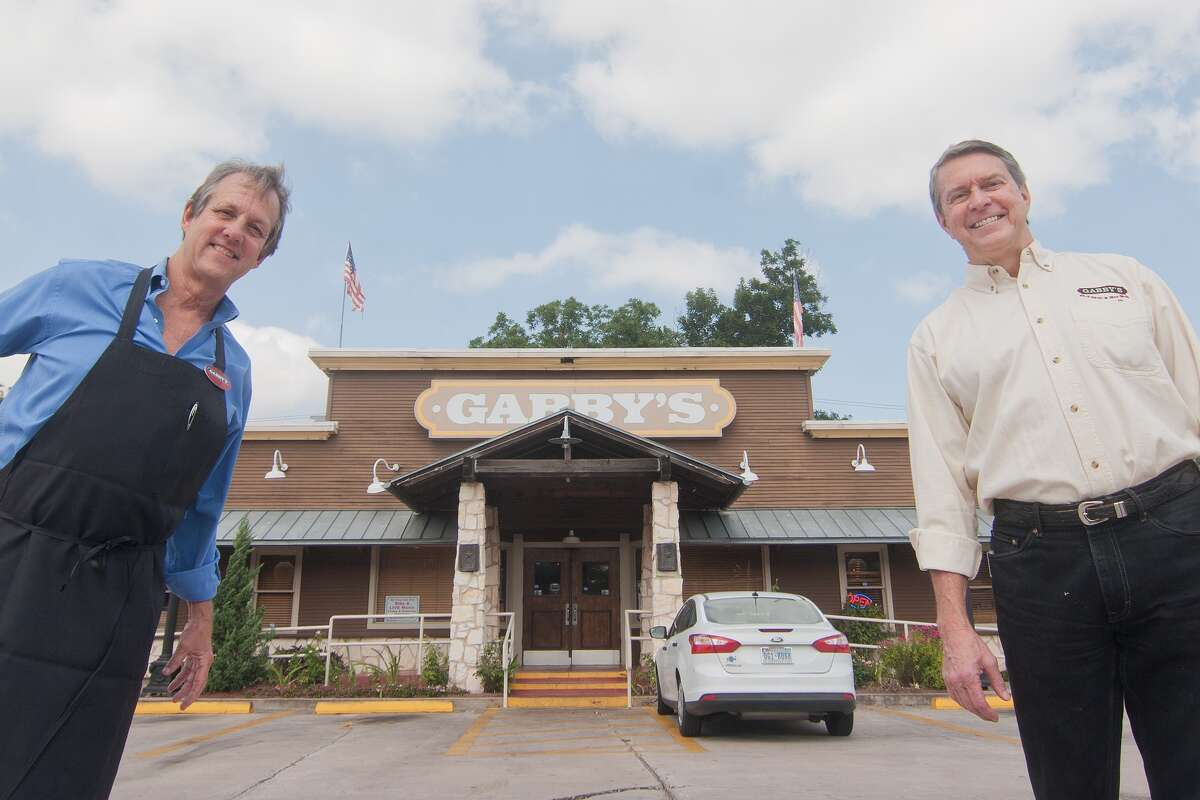 Gabby's BBQ owners Frank Roche, left and John Mariner say they enjoy meeting customers at the restaurant's locations, including this one at 3101 North Shepherd.