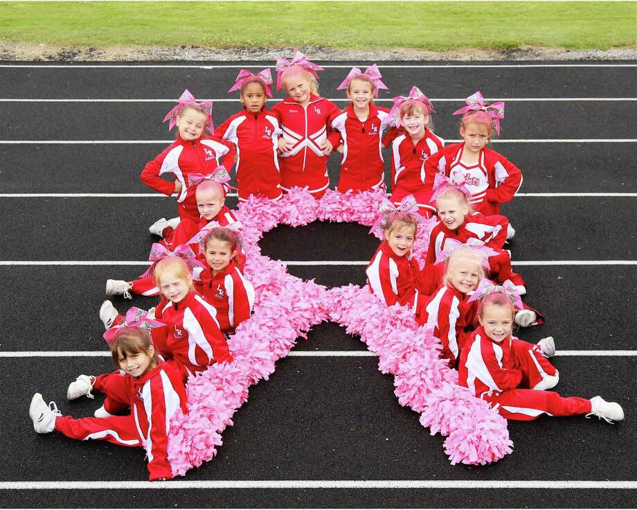 Lumberton pee-wee cheerleaders have lead the crowds with their cheers and chants all season. They are also showing their leadership by supporting breast cancer awareness for the month of October with there pink pom-poms, hair and bows. Left to right: Trulie Eason, Kensley Watkins, Gigi Overby, Bailey Etue, Gabby Mason, Allyson Wells, Jaycee Kirbow, Madison Sheffield, Harley Simmons, Ava Barton, Ella Gaspard, Brenna Hooks, Brianna Benson, and Kyleigh Hill. Photo: Handout