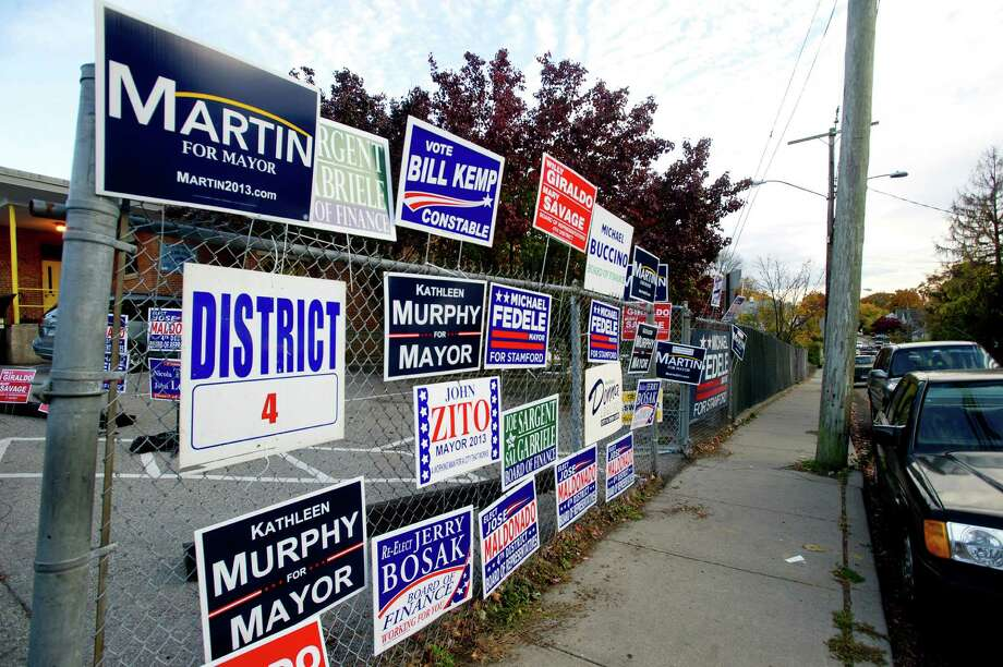Political signs litter the area around K.T. Murphy in Stamford, Conn., on Tuesday, November 5, 2013. Photo: Lindsay Perry / Stamford Advocate