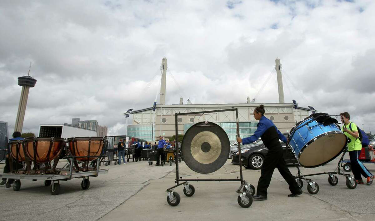 The Frenship High School drum line moves their instruments from the parking lot into the Alamodome on Tuesday Nov. 5, 2013. The band from Wolfforth was participating in the 2013 UIL State Marching Band Contest on Tuesday Nov. 5, 2013.