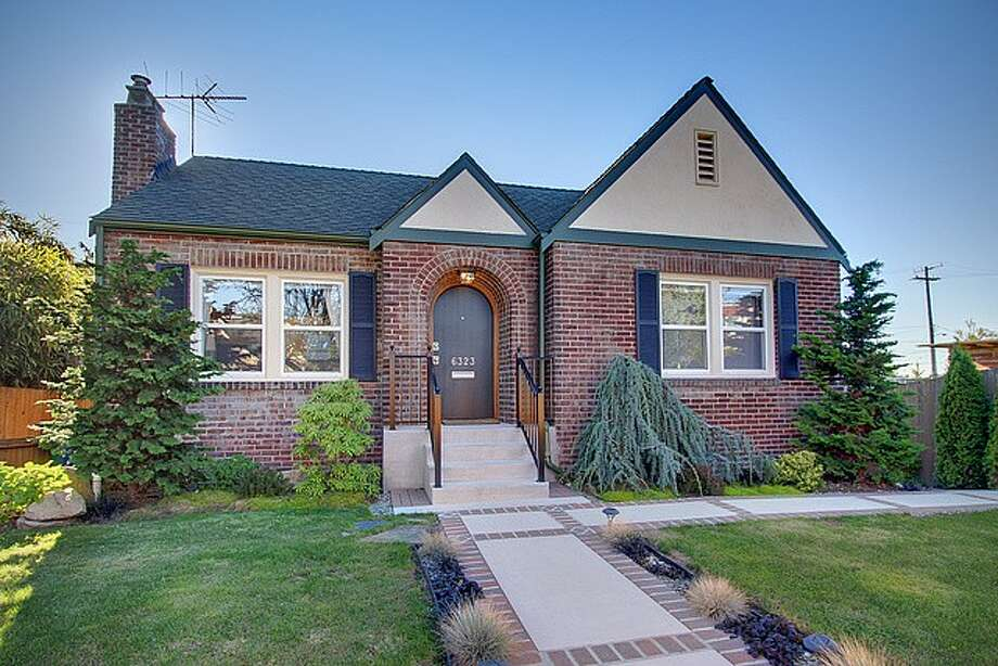 The lowest-priced home on our tour, at $335,000, is 6323 34th Ave. S.W. The 2,120-square-foot brick Tudor, built in 1929, has three bedrooms, 1.75 bathrooms, arched doorways, coved ceilings, an updated kitchen, a finished basement and a deck on a 2,924-square-foot lot. Photo: Jenny Jenkins,  Vicaso.com,  Albert Clark,  NWG Real Estate