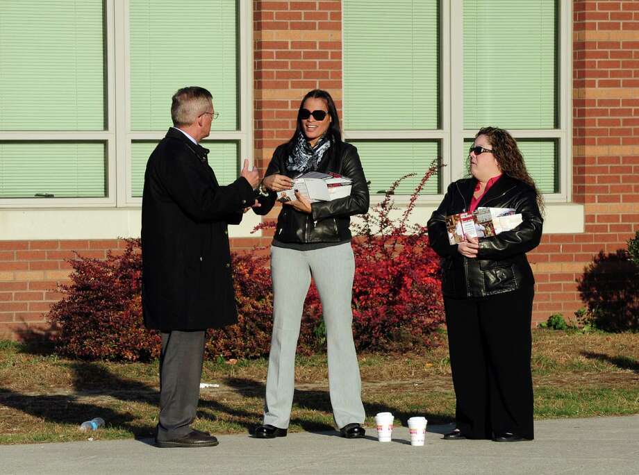 Bridgeport City Council candidate Ethan Book, left, chats with volunteers Carmen Serrano, center, and Alice Franceskino, during Election Day at Cesar A. Batalla School in Bridgeport, Conn. on Tuesday November 5, 2013. Photo: Christian Abraham / Connecticut Post