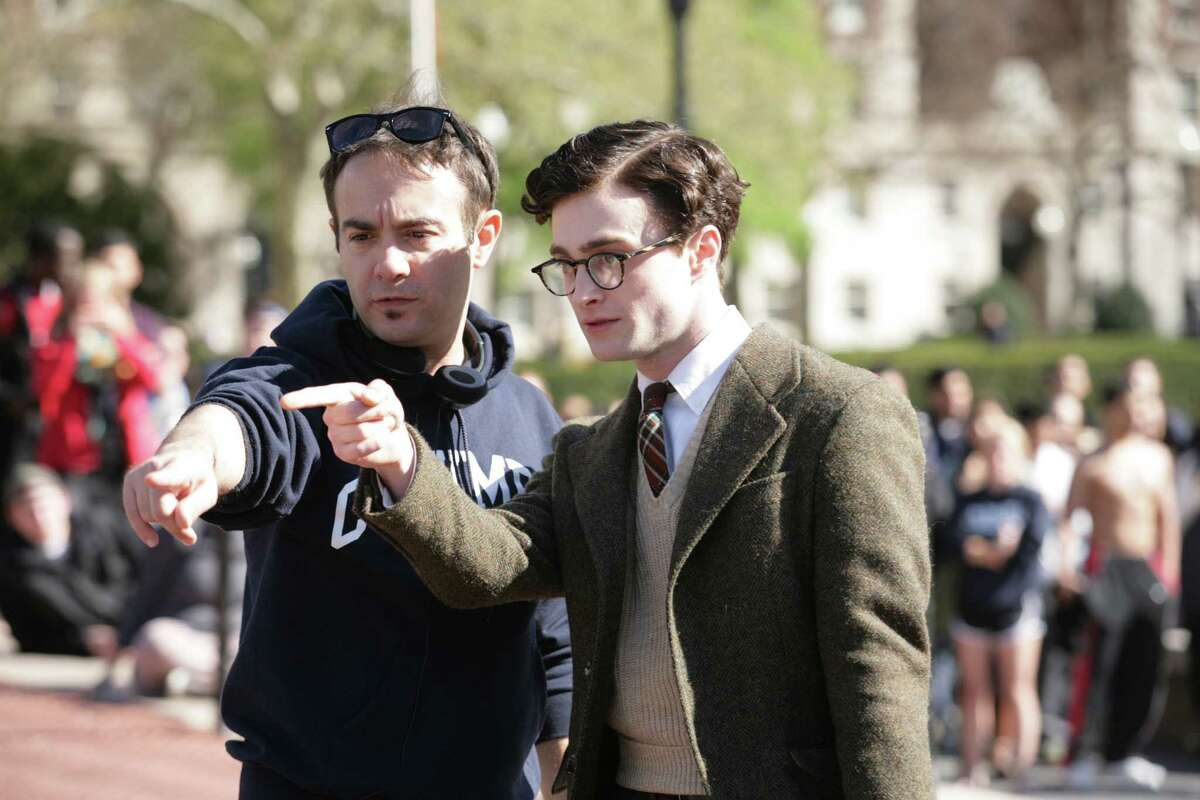Director John Krokidas, left, and Daniel Radcliffe talk on the set of