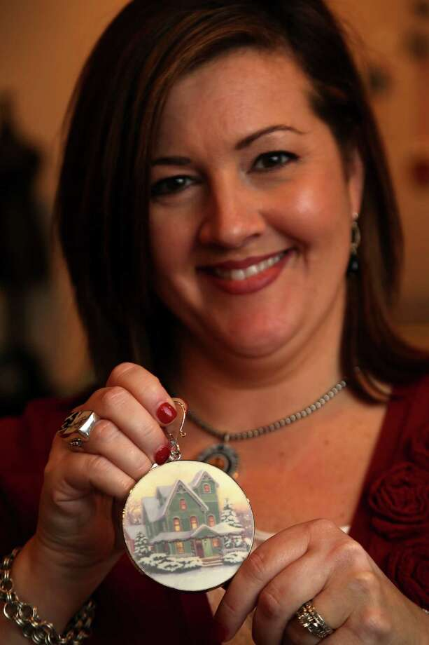 Christie Gunter, of China Baroque, who makes jewelry and other items such as this Christmas ornament, out of china pieces, Monday, Oct. 28, 2013, in Houston. She and her design team use old china pieces to make the custom jewelry collection and they will be showing at the upcoming Nutcracker Market.  ( Karen Warren / Houston Chronicle ) Photo: Karen Warren, Staff / © 2013 Houston Chronicle