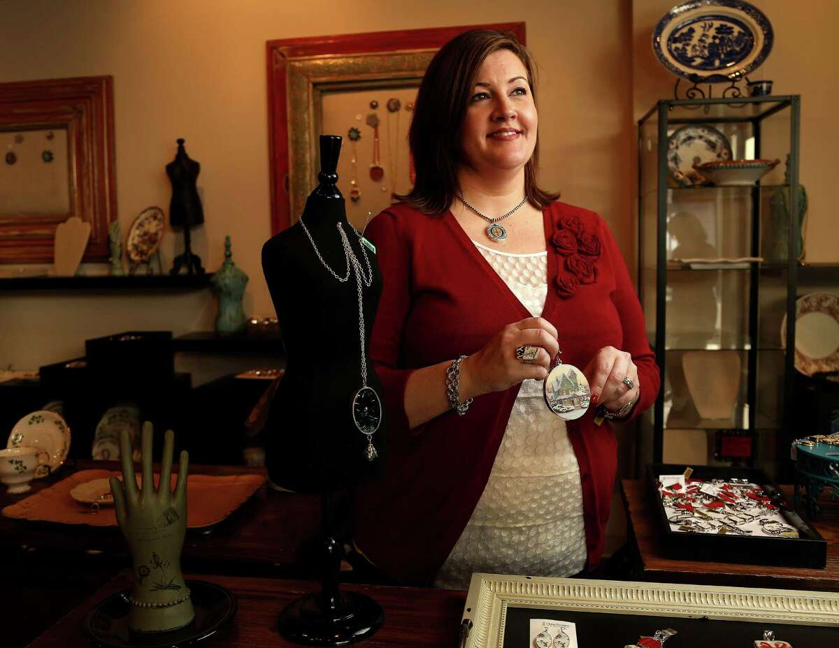 Christie Gunter, of China Baroque, who makes jewelry and other items such as this Christmas ornament, out of china pieces, Monday, Oct. 28, 2013, in Houston. She and her design team use old china pieces to make the custom jewelry collection and they will be showing at the upcoming Nutcracker Market. ( Karen Warren / Houston Chronicle )