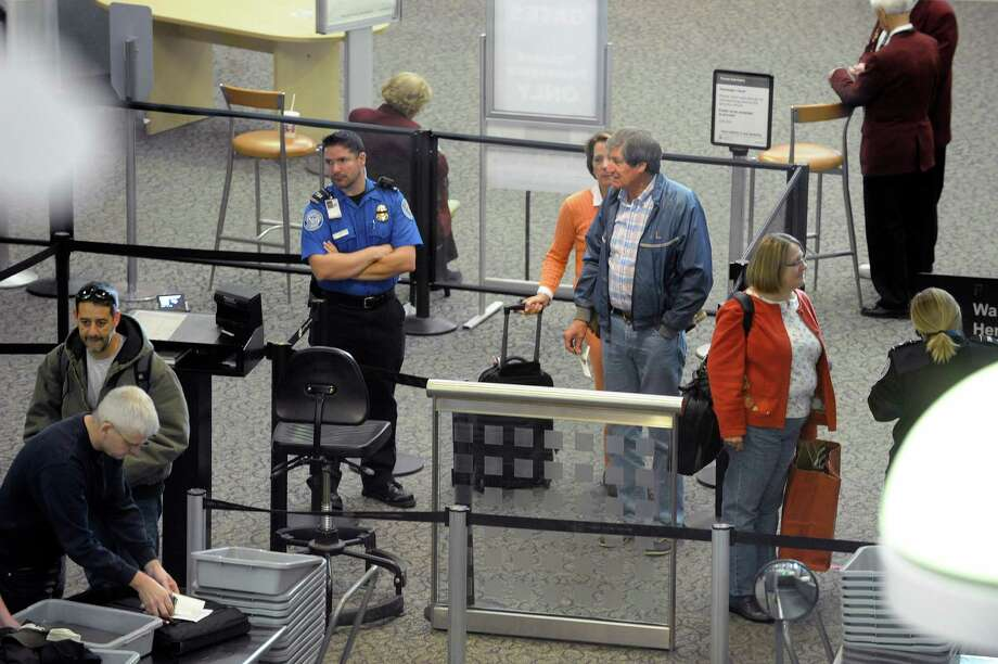 Travelers make their way through security at the Albany International Airport on Tuesday, Nov. 5, 2013 in Colonie, NY.   (Paul Buckowski / Times Union) Photo: Paul Buckowski / 00024530A