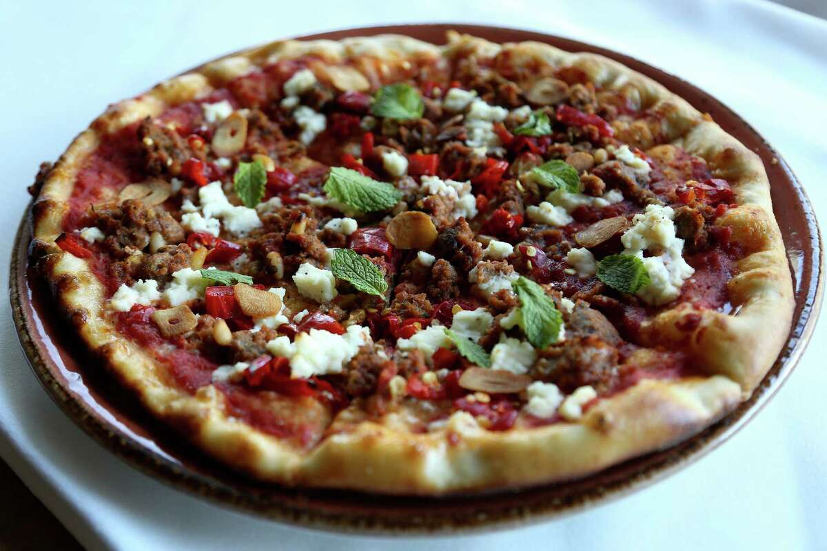 The Polpette pizza (made with lamb sausage meatballs, garlic, ricotta and mint) at Osteria Mazzantini, Friday, Nov. 1, 2013, in Houston. ( Karen Warren / Houston Chronicle )