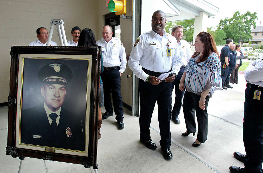 Fire Chief Charles Hood greets his command staff before ceremonies dedicated to former Fire Chielf I.O. Martinez. Photo: Tom Reel, San Antonio Express-News