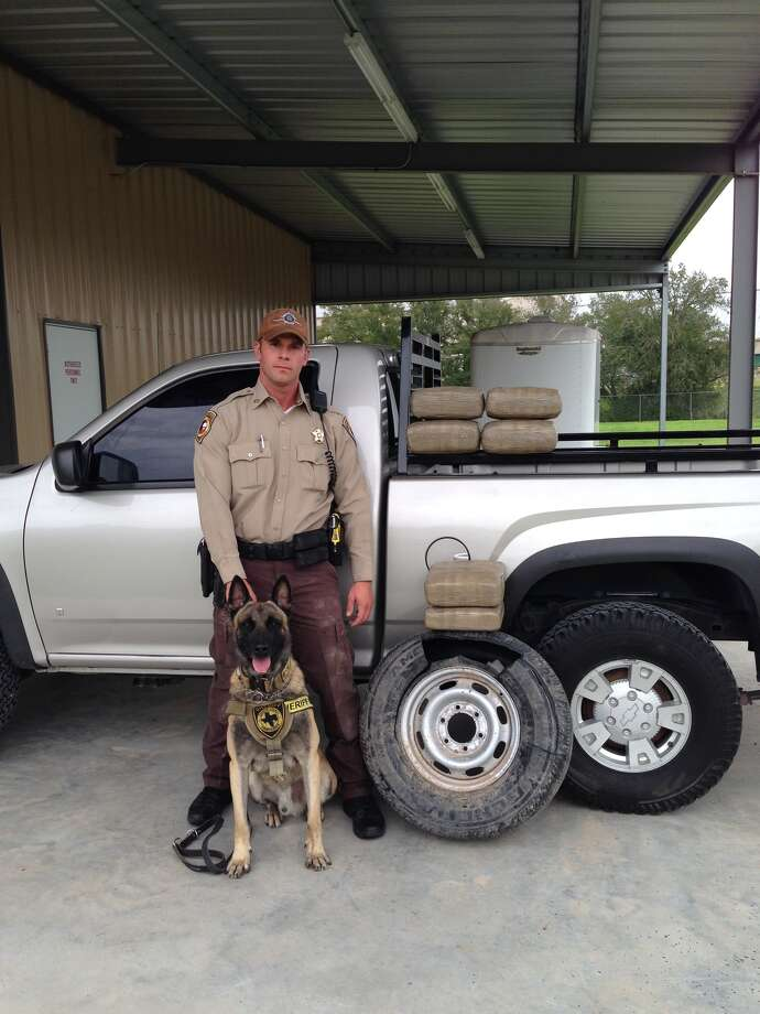 Deputy Randy Thumann and K-9 officer Lobos with their discovery. (FCSO)