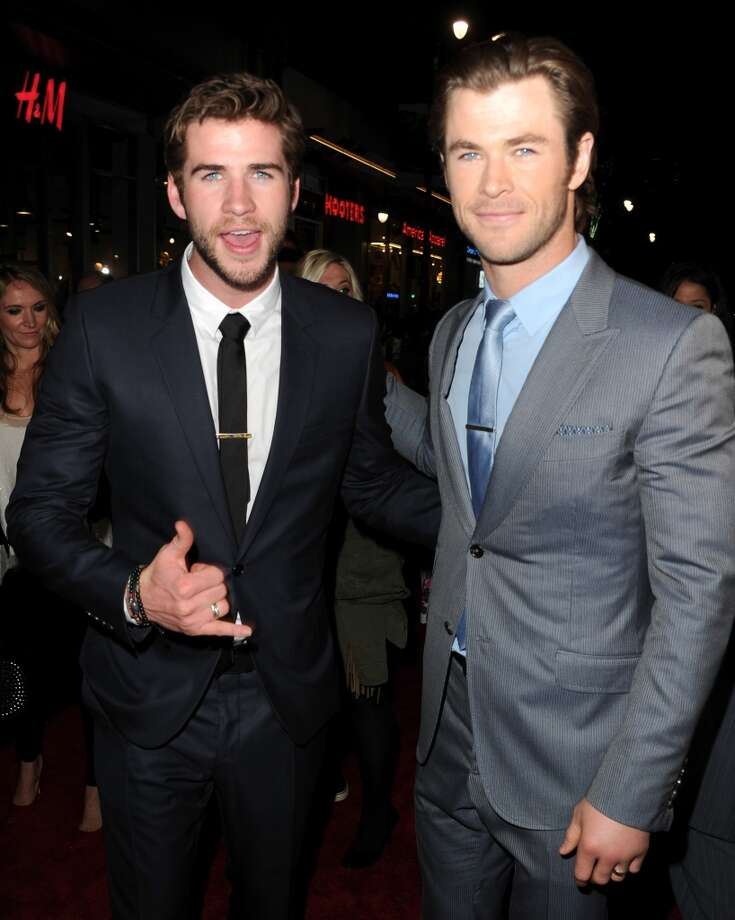 "Actors Liam Hemsworth (L) and Chris Hemsworth arrive at the premiere of Marvel's ""Thor: The Dark World"" at the El Capitan Theatre on November 4, 2013 in Hollywood, California.  (Photo by Kevin Winter/Getty Images) Photo: Getty Images"