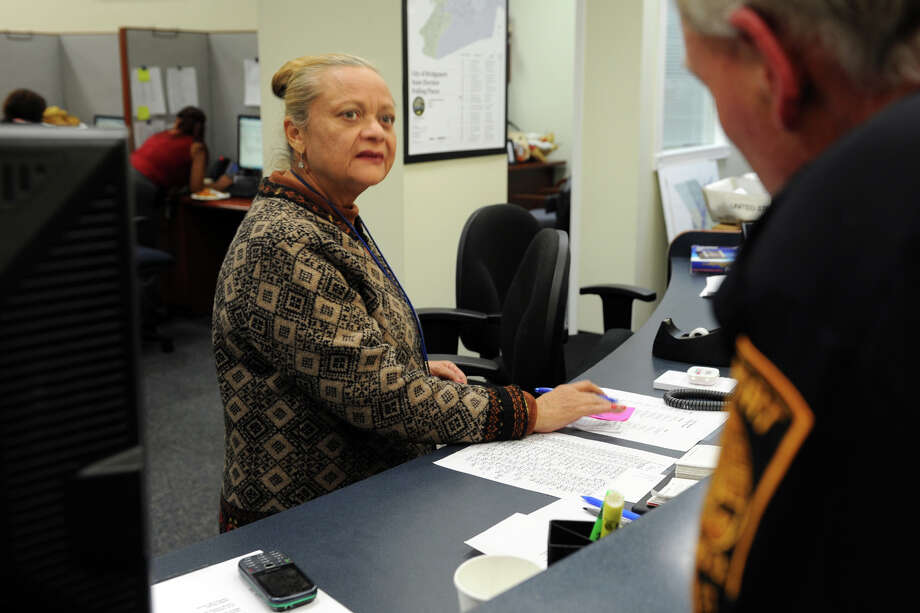 Democratic Registrar of Voters Santa Ayala speaks with Police Officer Pete Koval in the Registrar of Voters office on Election Night, in Bridgeport, Conn., Nov. 5, 2013. Photo: Ned Gerard / Connecticut Post