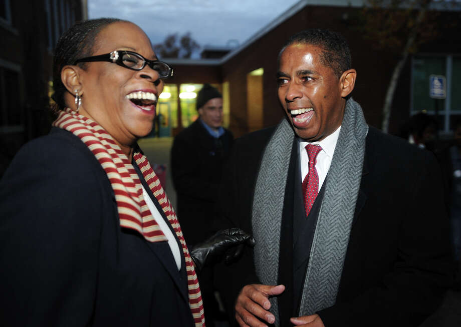 Connecticut state treasurer Denise Nappier, left, laughs with Stratford Democratic candidate for mayor Joe Paul outside Nichols School in Stratford, Conn. on Tuesday, November 5, 2013. Photo: Brian A. Pounds / Connecticut Post
