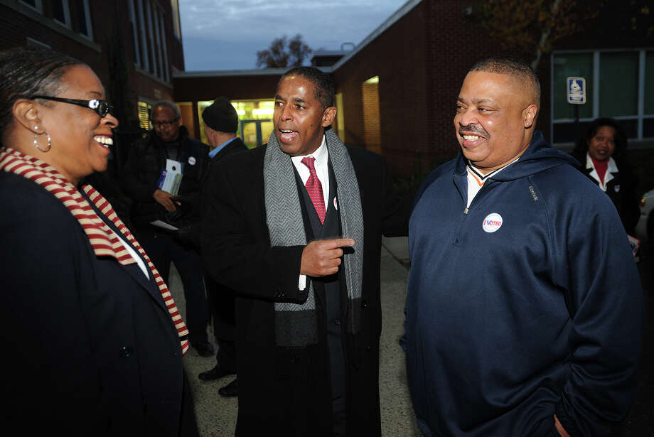 Stratford Democratic candidate for mayor Joe Paul, center, introduces state Treasurer Denise Nappier, left, to Stratford voter Jeffrey Williams outside Nichols School in Stratford, Conn. on Tuesday, November 5, 2013. Paul was Williams' coach for Bridgeport Central High School football in the early 1970's. Photo: Brian A. Pounds / Connecticut Post