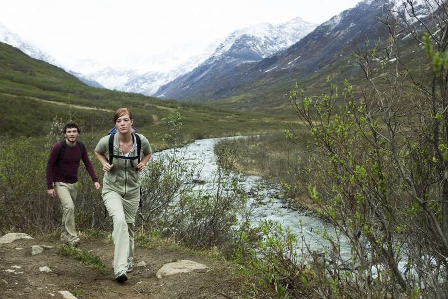 Go sightseeing in Alaska while hiking its mountainous terrain. Photo: Nicholas J Reid, Getty Images