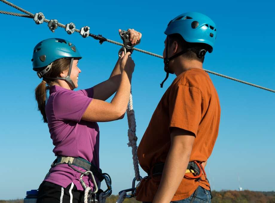 Go ziplining  in Sonoma county, a quick and fun way to see amazing aerial views together. Photo: Mark Rose, Getty Images