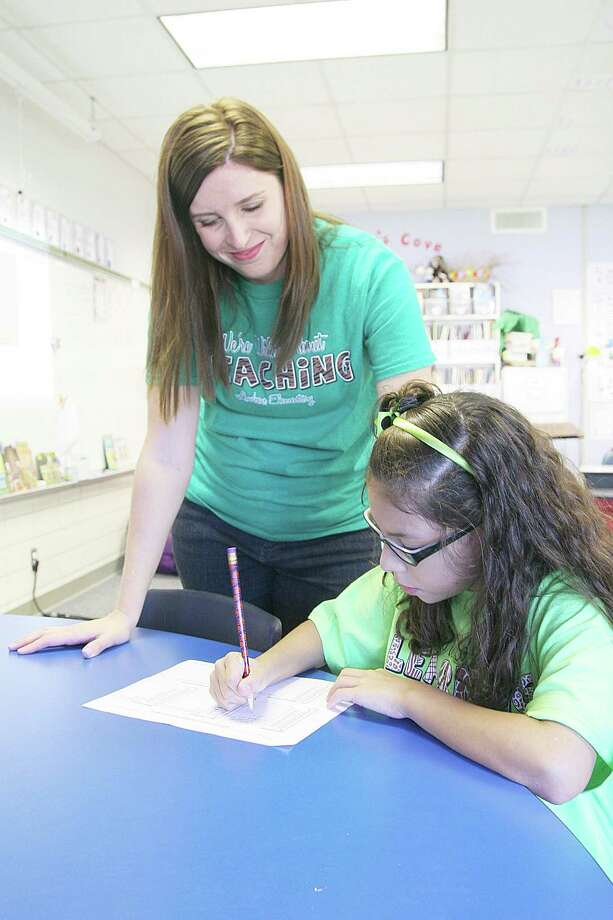 Fourth-grade teacher Katie Strong helps Mia Quiroga, 10, set academic goals for the school year. Photo: Pin Lim, Freelance / Copyright Pin Lim.