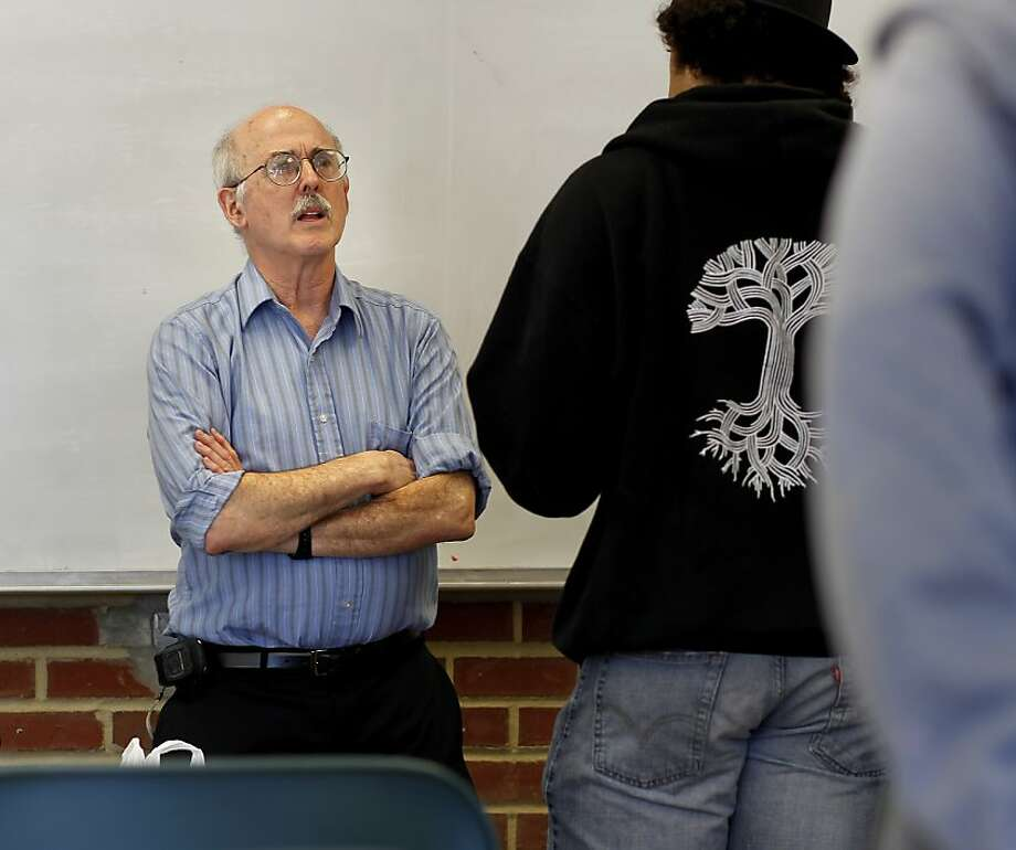 Bill Lepowsky talks with a student before his statistics class at Laney College in Oakland. Lepowsky, bullied by previous co-workers, later received an apology from the chancellor. Photo: Brant Ward, The Chronicle