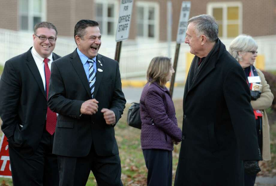 Democratic Mayor James Della Volpe, right, and Republican challenger David Cassetti talk while both campaigned outside Mead School in Ansonia, Conn. Tuesday, Nov. 5, 2013. Photo: Autumn Driscoll / Connecticut Post