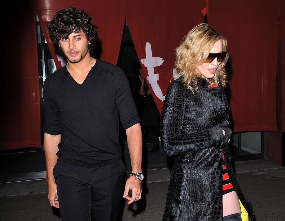 It's not only male musicians who date models. Madonna dated Brazilian model Jesus Luz — he was 28 years younger than here — for a brief period in 2010. Photo: James Devaney, WireImage