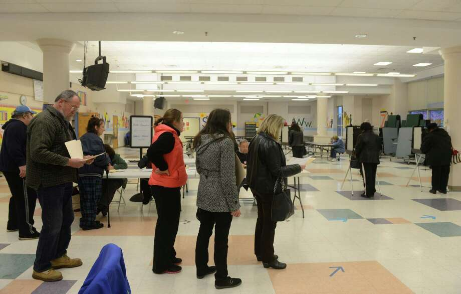 Residents line up to vote at John G. Prendergast School in Ansonia, Conn. Tuesday, Nov. 5, 2013. Photo: Autumn Driscoll / Connecticut Post