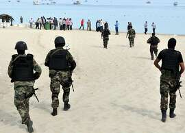 "Tunisian security forces inspect a beach after a failed suicide bomb attack near the four-star Riadh Palms hotel, in the resort town of Sousse, a popular tourist destination 140 kilometres (90 miles) south of Tunis, on October 30, 2013.  Tunisian security forces arrested five Salafist ""terrorists"" with links to two failed attacks in coastal resort towns, the first suicide bids in the country for more than a decade. Today's failed suicide bombings are the first in Tunisia since 2002, when an attack claimed by Al-Qaeda killed 21 people at the ancient Ghriba synagogue on the resort island of Djerba.  AFP PHOTO/STRSTR/AFP/Getty Images"