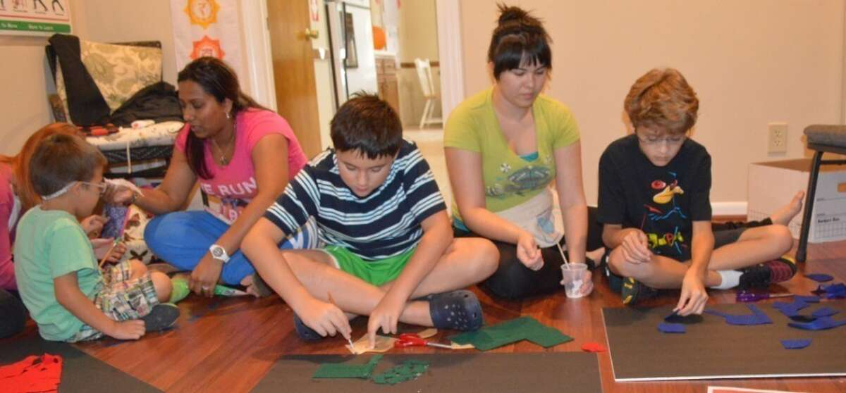 Students at Katy Learning Center participate in a sensory exercise.