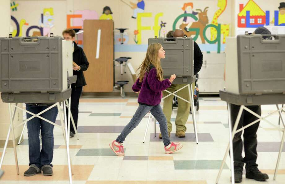 Voters fill out their ballots at John G. Prendergast School in Ansonia, Conn. Tuesday, Nov. 5, 2013. Photo: Autumn Driscoll / Connecticut Post