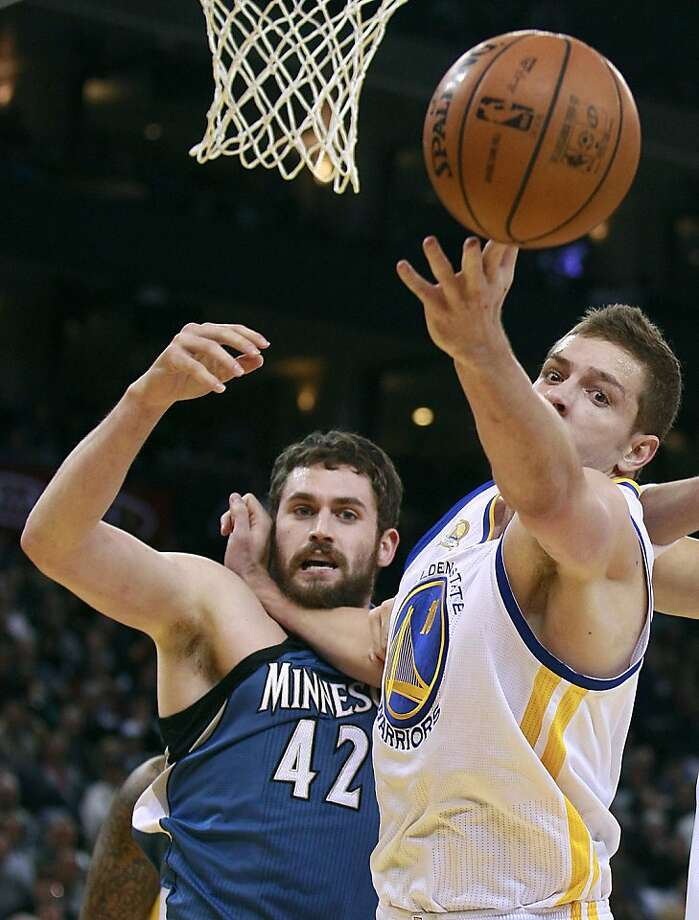 Minnesota's Kevin Love (left) is the first of three top power forwards the Warriors' David Lee will face this week. Photo: Jeff Chiu, ASSOCIATED PRESS