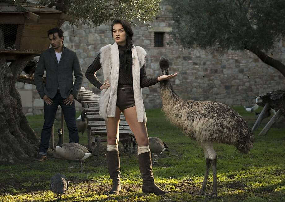 Something wild: On Hannah: Marc Jacobs sweater, $625, and Marc Jacobs shorts, $595, both Marc Jacobs, S.F.; Fabiana Filippi sweater vest & belt, $1,535, Nordstrom; Konstantino ring, $990, Neiman Marcus; boots, stylist's own. On Hugo: Rag & Bone coat, $695, Nordstrom; Marc Jacobs sweater, $1,280, Marc Jacobs, 125 Maiden Lane, S.F., $1,280; Levi's jeans and boots, model's own. Photo: Russell Yip, The Chronicle