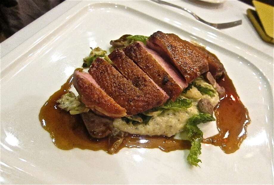 Duck special with polenta and wilted greens at Osteria Mazzantini Photo: Alison Cook