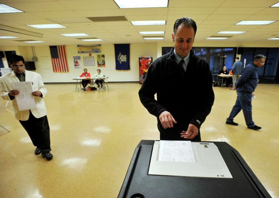 Jason Wood casts his vote at Cloonan Middle School in Stamford, Conn., on Tuesday, Nov. 5, 2013. Photo: Jason Rearick / Stamford Advocate