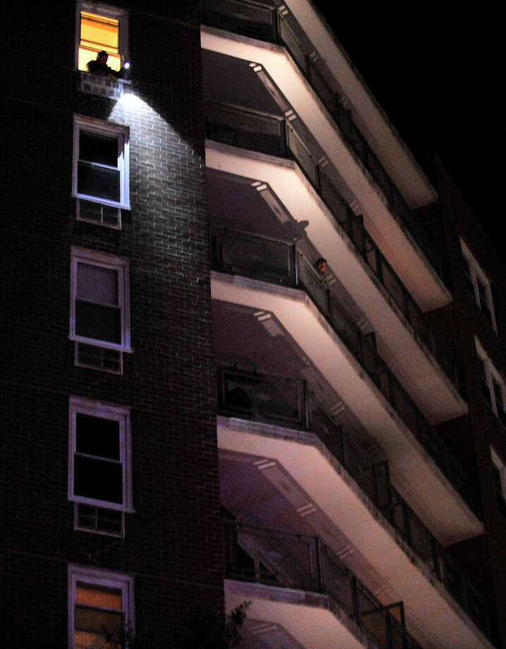 Authorities investigate the scene where a woman fell from the 11th floor of the Founatin Terrace at Strawberry Hill high rise in Stamford, Conn., on Tuesday, Nov. 5, 2013. Photo: Jason Rearick / Stamford Advocate