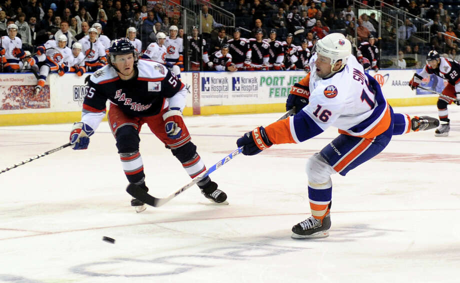 Jon Sim takes a shot at goal for the Soundtigers during Saturday's game against the Hartford Wolf Pack at the Arena at Harbor Yard on November 6, 2010. Photo: Lindsay Niegelberg, ST / Connecticut Post