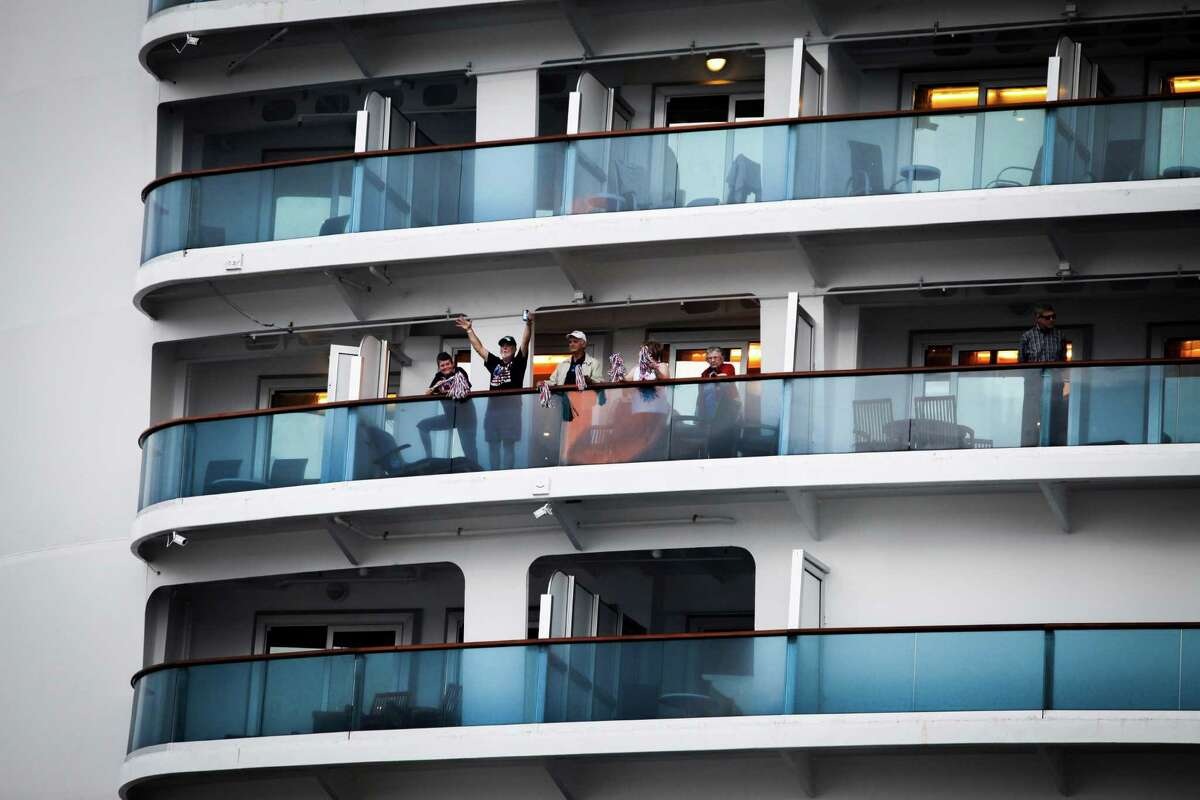 Vacationers wave goodbye as the cruise ship Caribbean Princess leaves from the Bayport Cruise Terminal Nov. 5, 2013 in Pasadena, TX.