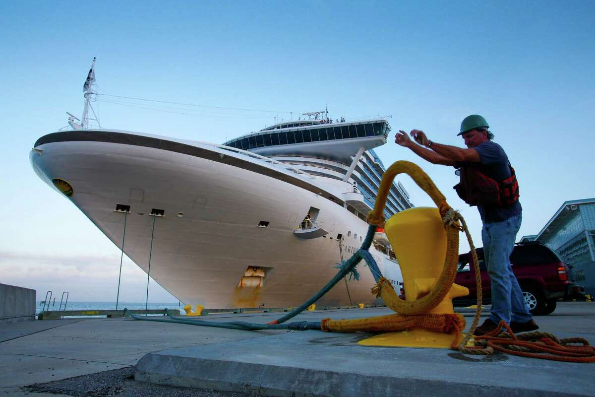 Boatman Mark Henry tosses a mooring line off a bollard as the cruise ship Caribbean Princess prepares to leave from the Bayport Cruise Terminal Nov. 5, 2013 in Pasadena, TX.