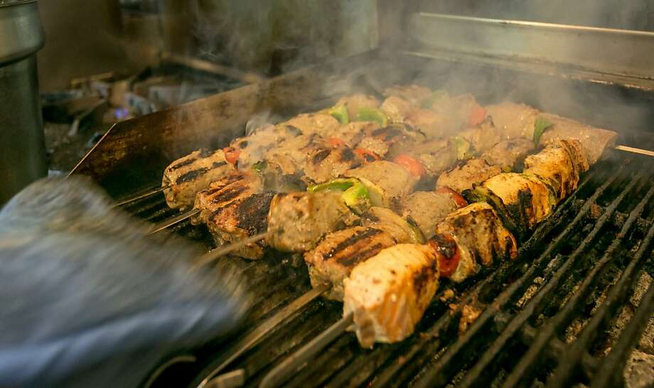 Kabobs cook on the grill at Roya Afghan Cuisine in Livermore. The restaurant offers several varieties. Photo: John Storey