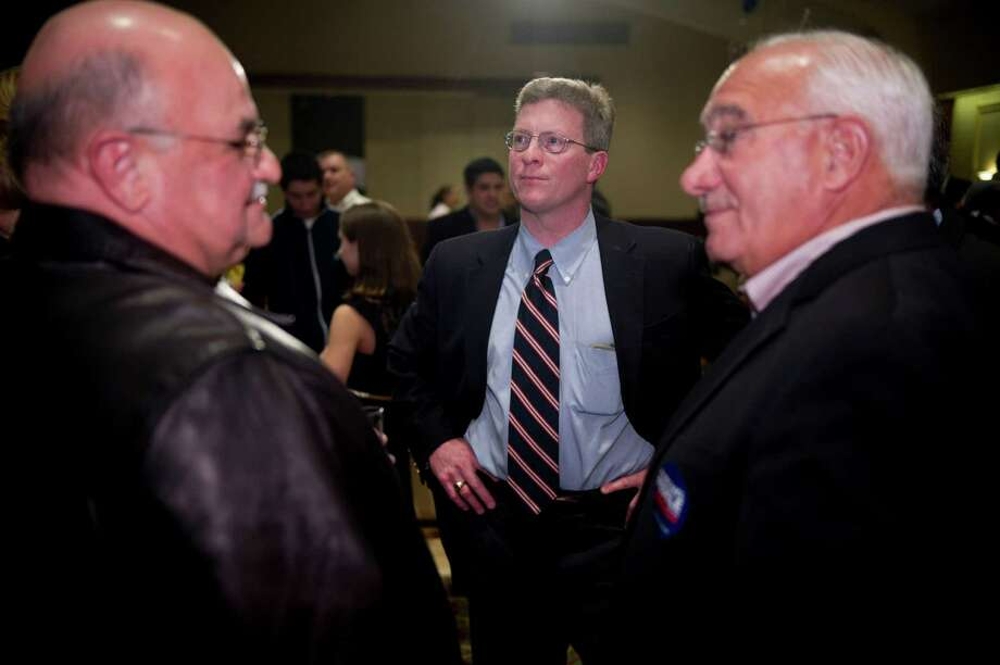 Board of Education candidate John Leydon, Jr. watches election results with Boardo of Representatives member Carl Franzetti, left, and Stamford's Director of Operations Ernie Orgera, right, at the Italian Center in Stamford, Conn., on Tuesday, November 5, 2013. Photo: Lindsay Perry / Stamford Advocate