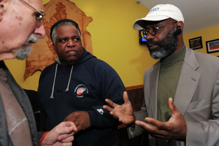 Democrat Howard Gardner talks with Don Greenberg, left, and John Bagley on Election Night at the Red Rooster Deli, in Bridgeport, Conn., Nov. 5, 2013. Howard secured a seat on the Bridgeport Board of Education. Photo: Ned Gerard / Connecticut Post