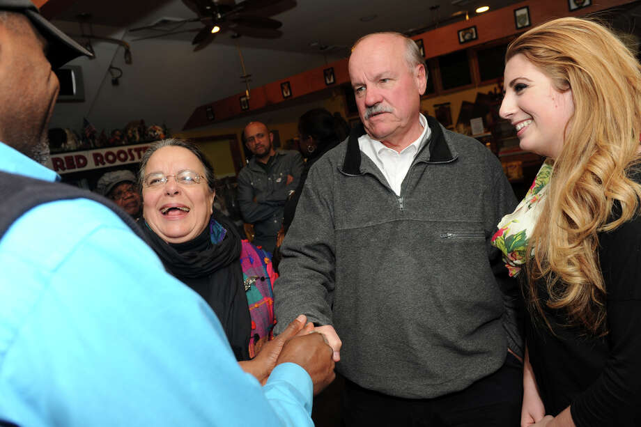 David Hennessey, center, receives congratulations from fellow democrat, Andre Baker, at the Red Rooster Deli, in Bridgeport, Conn., Nov. 5, 2013. Hennessey and Baker both secured seats on the Bridgeport Board of Education. Photo: Ned Gerard / Connecticut Post