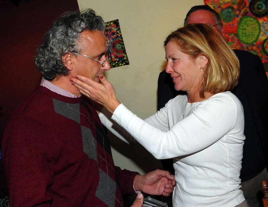 Gabrielle Parisi, a PAC Chairperson with Citizens Working for a Better Bridgeport, congatulates Republican Rick Torres after Torres won a seat on the Bridgeport City Council at Harborview Market in Bridgeport, Conn. on Tuesday November 5, 2013. Photo: Christian Abraham / Connecticut Post