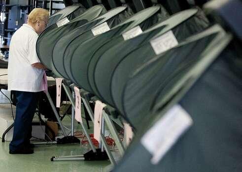 Jacqueline Bushman votes at Wainwright Elementary School on election day Tuesday, Nov. 5, 2013, in Houston. Photo: Johnny Hanson, Houston Chronicle / Houston Chronicle