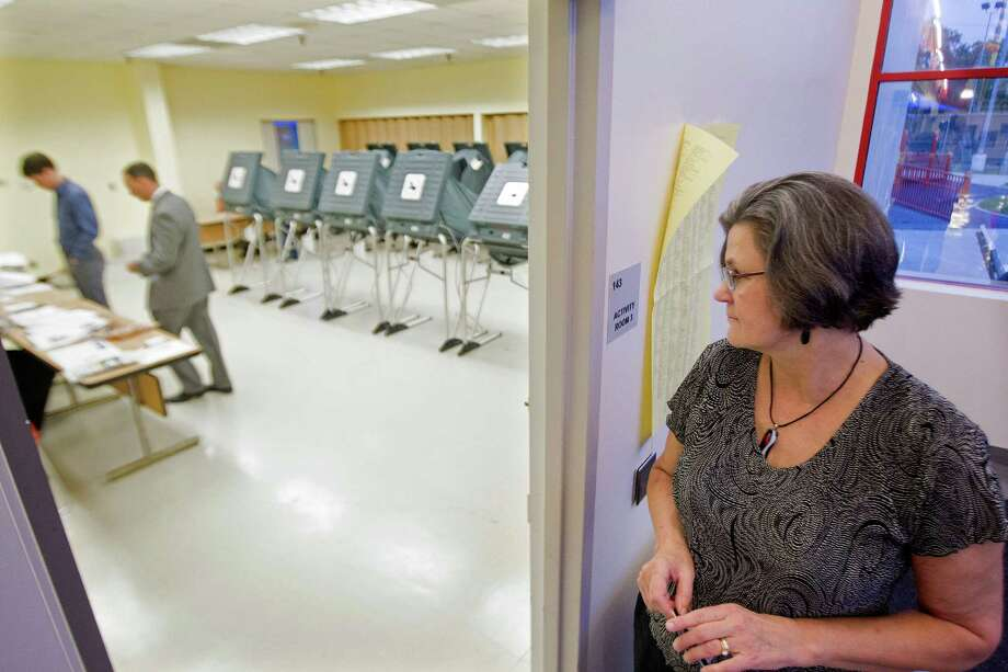 Beverly Newman. right, waits in line before voting at the Metropolitan Multi-Service Center Tuesday, Nov. 5, 2013, in Houston. Newman, who is a teacher, said it's important for her to vote and be an example for her students. Photo: Johnny Hanson, Houston Chronicle / Houston Chronicle