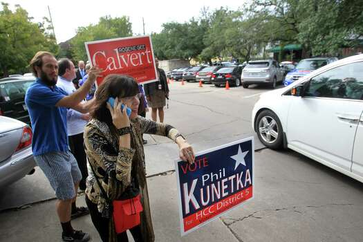 Norma Welscher urges people to vote outside the polling location at Christ the King Evangelical Lutheran Church on Election Day on Tuesday, Nov. 5, 2013, in Houston. Photo: Mayra Beltran, Houston Chronicle / © 2013 Houston Chronicle