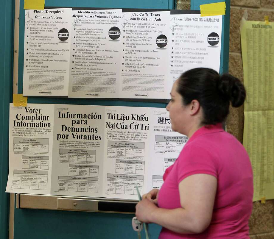 A woman walks into the polling area at the Denver Harbor Park Community Center Tuesday, Nov. 5, 2013, in Houston. Photo: James Nielsen, Houston Chronicle / © 2013  Houston Chronicle