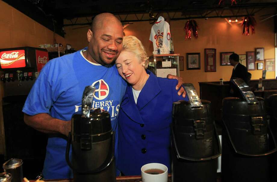 Owner Marcus Davis embraces Mayor Annise Parker as she waits for her breakfast at The Breakfast Klub where staff and supporters started Election Day on Tuesday, Nov. 5, 2013, in Houston. Photo: Mayra Beltran, Houston Chronicle / © 2013 Houston Chronicle