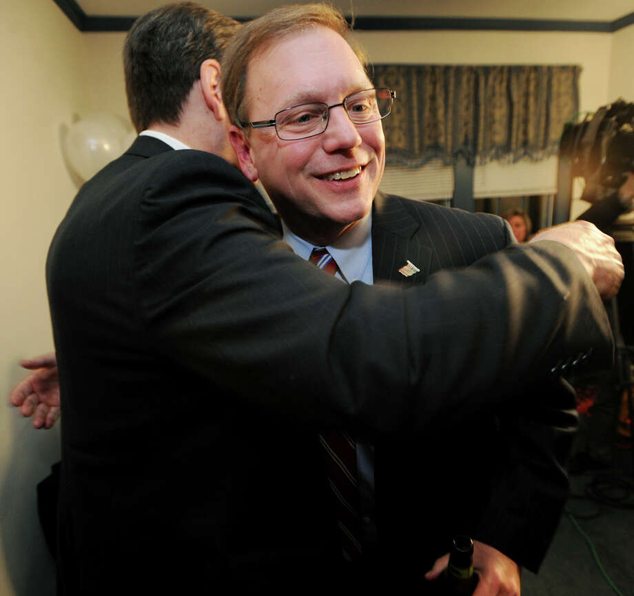 Stratford Mayor John Harkins, facing, is hugged by his brother, Mike Harkins, of Shelton, following his victory over Democratic challenger Joe Paul at Republican headquarters in Stratford, Conn. on Tuesday, November 5, 2013. Photo: Brian A. Pounds / Connecticut Post
